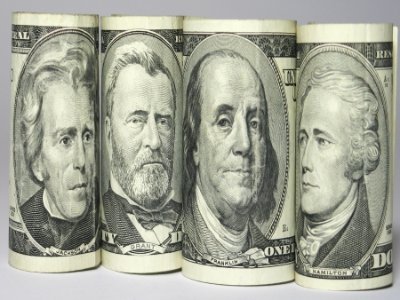 Four portraits on banknote like team in row Stock Photo