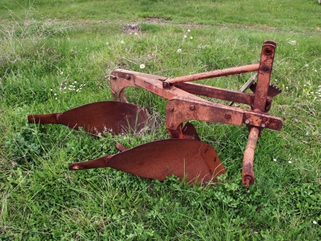 the plough: Old plough on the grass