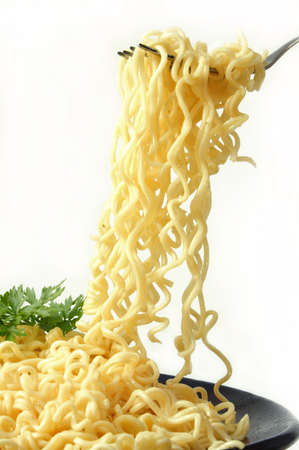portion of spagetti in a dish on a white background Фото со стока