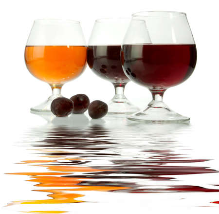 Dark wine in glasses on a glass table