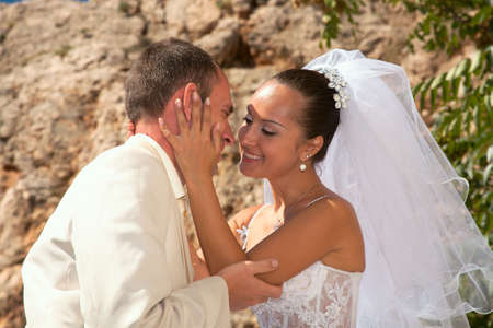 Happy married couple. Photosession on open air in a landscape of mountains of Crimea. Фото со стока