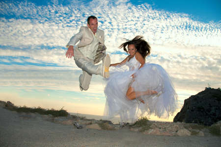 Happy married couple. Photosession on coast of the black sea.