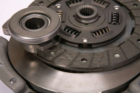 Spare parts of motor vehicle forming clutch plate and disc. Фото со стока