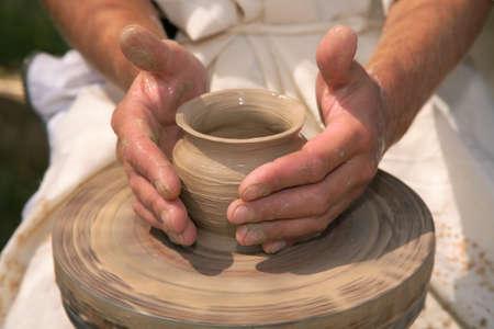 Magic transformation of a piece of clay into the true  utensils. Фото со стока