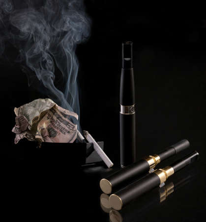Set for smoking. The electronic cigarette has the big popularity at interested persons to not smoke. Stock Photo - 15015479