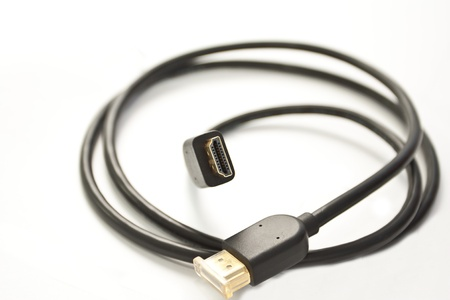 conductivity: Black cord for a signal transmission on a white background Stock Photo