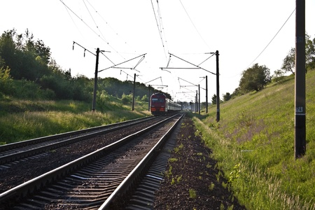 cross ties: Coming nearer a train, the express train by rail against the nature