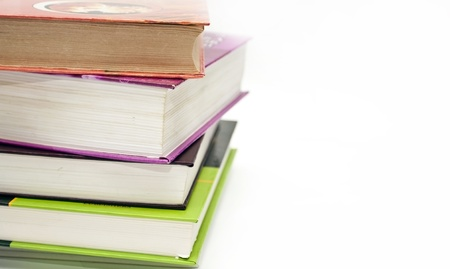 Thick educational books on a white background