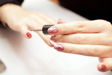 plotting: Process of plotting of a varnish on female nails