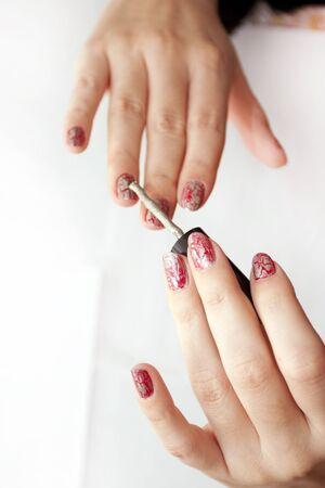 the plotting: Process of plotting of a varnish on female nails