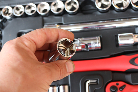 Tool kit for the mechanic - the chromeplated heads, graggerses, screw-drivers photo