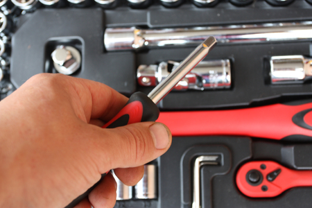Tool kit for the mechanic of a car - the chromeplated heads, graggerses, screw-drivers photo