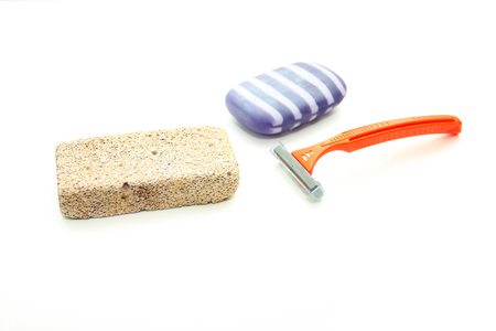 porosity: Different means of hygiene - pumice, the machine for shaving and soap on a white background