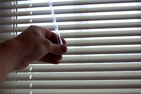 Bright sunlight when opening by a hand of curtains of blinds