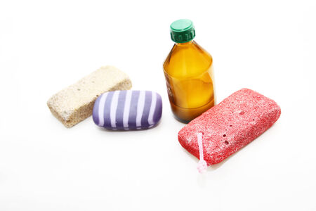 porosity: Different means of hygiene - pumice, soap and lotion on a white background Stock Photo