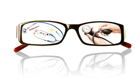 Paintings on the glasses with a medical theme and mirror image on a white background photo