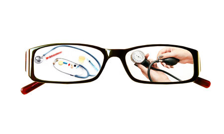 Paintings on the glasses with a medical theme  on a white background photo