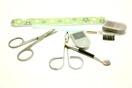 Set van cosmetische hulpmiddelen - schaar, een nagelvijl, een pincet, een borstel voor wimpers Stockfoto