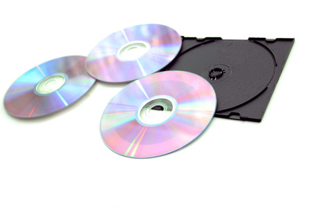 Compact disks and black box on a white background