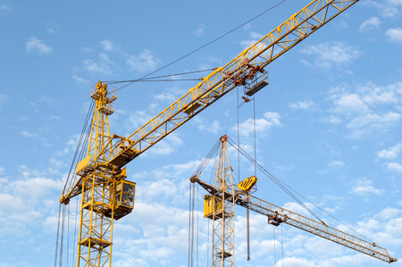 Construction of the new brick building by means of the elevating crane on open space photo