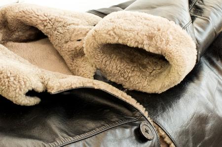 Leather natural sheepskin coat of black color with fur
