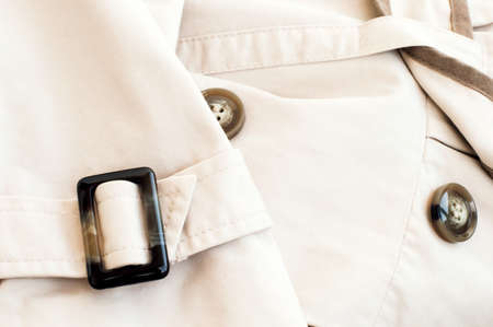 inserts: Texture - a white womens coat with inserts of coffee color