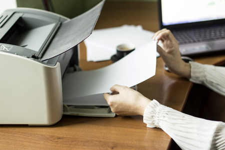 printer cartridge: The process of inserting paper in laser printer cartridge on an Office background Stock Photo
