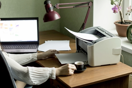 office background: Printing documents from your computer to your printer in the Office background Stock Photo