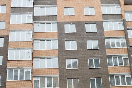 glass brick: The brick multi-storey building with glass balconies