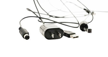adapters: Different Plugs with wires for power supply and adapters on a white