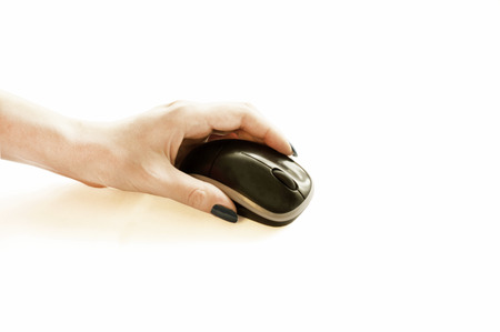 The process of manipulating electronic mouse for laptop on white background photo