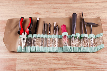 repairs: Set of various tools for repairs around the house on a background of wooden floor