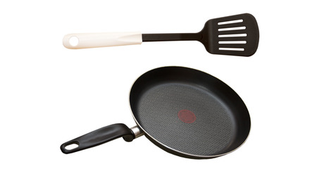 instance: Kitchen shovel and pan for cooking on a white background