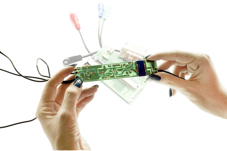 schemes: Electronic schemes in hands on a white background Stock Photo
