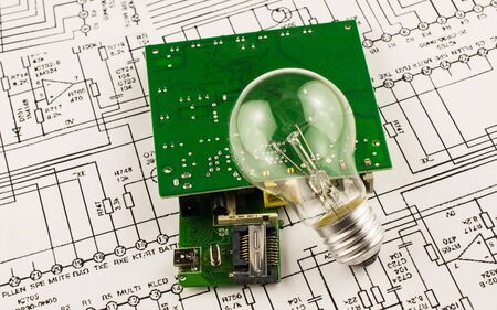 incandescence: Incandescence  lamp and chip on the background drawings of microcircuits