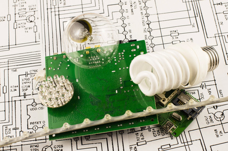 disconnecting: Different types of lamps and chips on the background drawings of microcircuits