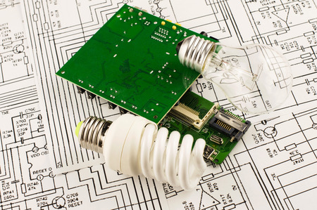 incandescence: fluorescent lamp, incandescence and chip on the background drawings of microcircuits Stock Photo