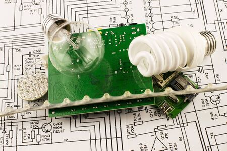 incandescence: Different types of lamps and chips on the background drawings of microcircuits