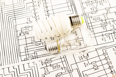 incandescence: fluorescent lamp and lamp incandescence against the background drawings of microcircuits