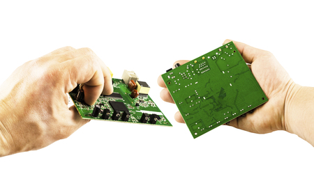 flux: Electronic microcircuit in the hands of different angles on a white background Stock Photo