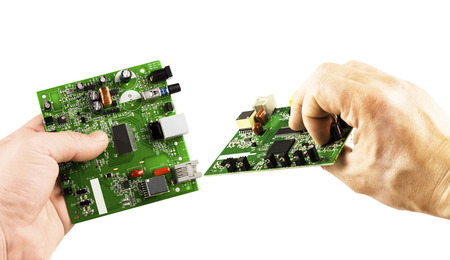 microcircuit: Electronic microcircuit in the hands of different angles on a white background Stock Photo
