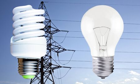 incandescent: Fluorescent light bulb and incandescent on blue background electric line support Stock Photo
