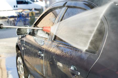 The process of washing the car at the car wash