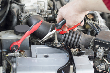The process of repair wiring car using pliers