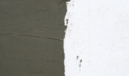 polyfoam: Textures, facade work - on the wall of foam plastic applied plastering
