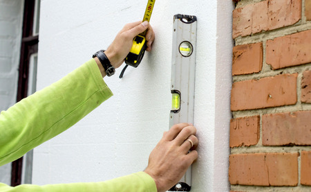 Check the evenness of the walls using foam plastic level
