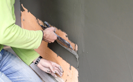 ade: The process of plastering the walls with a large metal spatula