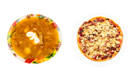 nutritiously: Pizza and borscht with sour cream in the plate on a white background