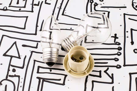 spiral: Incandescent lamp with a chuck on the background of the picture with microchips