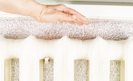 touching hands: Touching hands to cast iron radiator sections